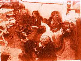 Women and children on the deck of a ship.