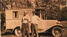 "Charles O. Bowen and ""Dad"" Silvernails in front of the Gospel Van."