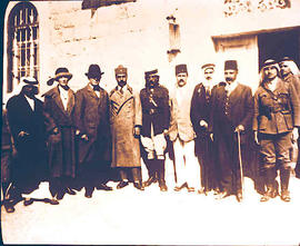 A group of Afghan and non-Afghan people standing in front of a building.
