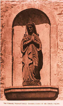 The Church, Saint-Famille, Wooden Statue of the Virgin (facade).