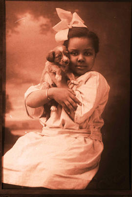 A portrait of a young girl and her dog.