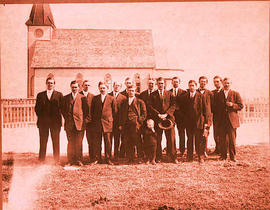 A group of men outside a church.