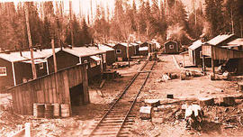 A loggers camp along a railway, possibly on Vancouver Island.