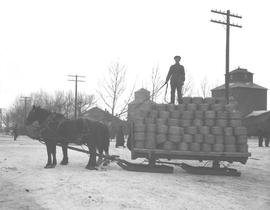 A ten ton load of wire being delivered to Chalmers' Hardware by L.G. Kelley's dray, Wetaskiwin, Alberta