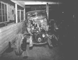 Photograph of a wrecked car at Vellner and Pearson's Garage, Wetaskiwin, Alberta.