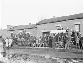 Group of men with an Oliver Tractor in front of the Elks' Hall, Wetaskiwin, Alberta
