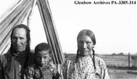Little Light with his wife and a child, Blackfoot (Siksika) reserve, Alberta.