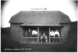 Gushul family in front of their photographic studio, Blairmore, Alberta.