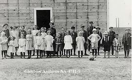 Pupils and teacher outside school, Alderson  (formerly Carlstadt), Alberta.
