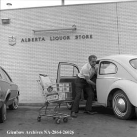 Car being loaded with beer, Calgary, Alberta.