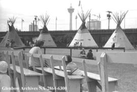 First Nations of Alberta tipis with Husky Tower [later renamed Calgary Tower] in background, Calg...