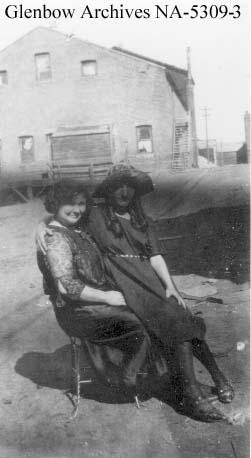 Mrs. Marionina Picariello with daughter, Angelina behind the Alberta Hotel, Blairmore, Alberta.