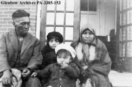 Billy Mayfield, his wife Maggie Mayfield, and their children, Blackfoot (Siksika) reserve, Alberta.