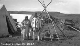 Family during Sun Dance gathering, Blackfoot (Siksika) reserve, Alberta.