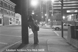 Girl leaning on lamp, feature about prostitution, Calgary, Alberta.