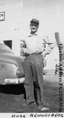 Hugo Renneberg standing beside automobile, probably Saskatchewan.