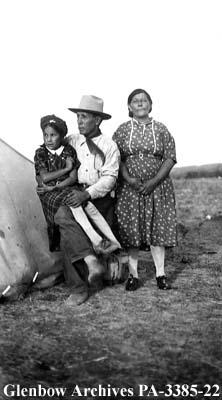 Joe Crowfoot with his wife and child, Blackfoot (Siksika) reserve, Alberta.