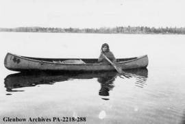 Mrs. Simeon Ballantyne in canoe on Deschambault Lake, Saskatchewan.