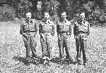 Four men in uniform