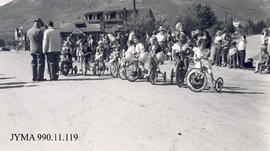Children on bicycles in parade, Jasper, Alberta.