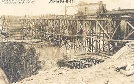 The construction of a trestle bridge over the McLennen River.