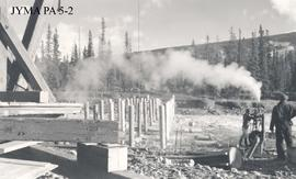 Construction of the west approach on the Athabasca Bridge, Jasper National Park, Alberta.