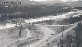 Aerial view of the Athabasca Bridge and fill during construction, Jasper National Park, Alberta.