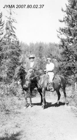 [R.H. Knight and Mabel Knight on horseback], Jasper National Park, Alberta