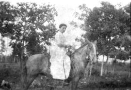Woman on horse.