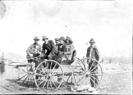 Group of two women and four men with buggy, Alberta.