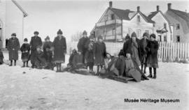Girls in front of the church and 2nd residential school at Onion Lake, Saskatchewan