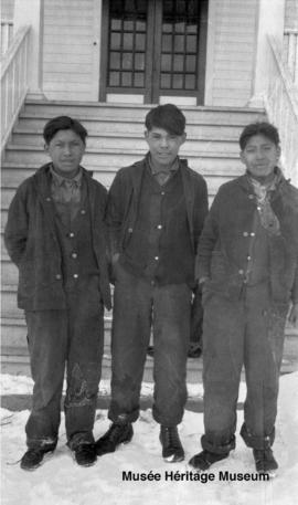 Boys in front of 3rd residential school at Onion Lake, Saskatchewan