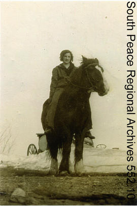 Wilma Harrop riding a horse
