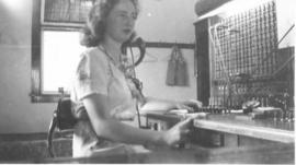 Woman sitting at the telephone switchboard, Okotoks, AB.