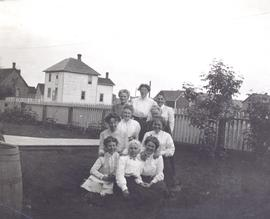 Group of 10 women in front of Thompson house, Okotoks, AB.