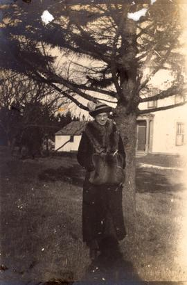 Hazel Newton standing in front of a tree, probably in Grand Manan, New Brunswick.