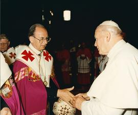 Metr. Bzdel gives the Pope his hand