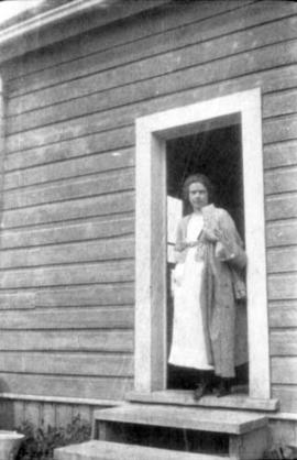 Woman standing outside H.B.C. Building