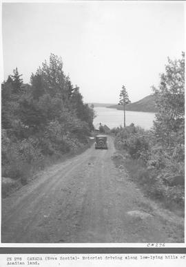 Canada. (Nova Scotia) Motorist driving along low-lying hills of Acadian land / CN276