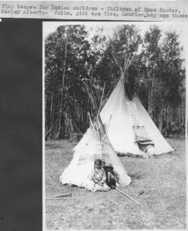 Play teepee for Indian children. Children of Enos Hunter Morley, Alberta. Julia, girl age five, L...